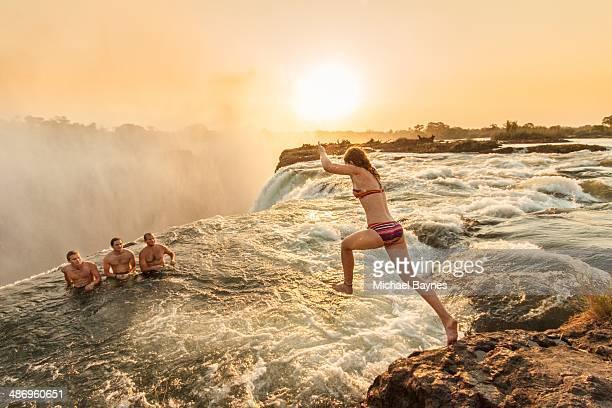 Jumping into devils pool Victoria falls Zambia