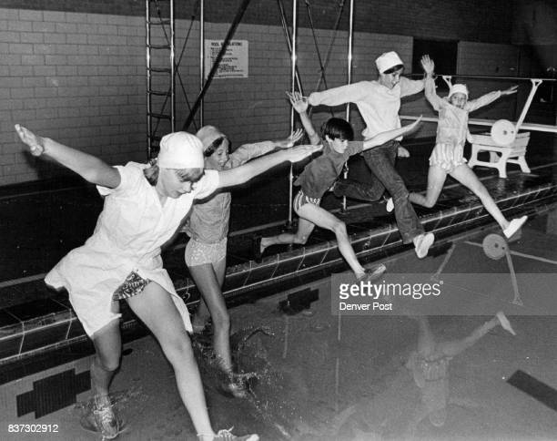 Jumping into Pool Are From Left Sandra Cox Cathy Cox Jeff Keefe Paula Quintana and Ellen Haworth Credit Denver Post Inc