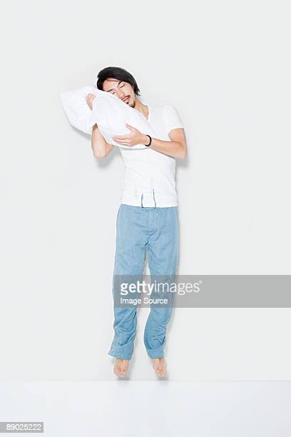 Jumping man with pillow