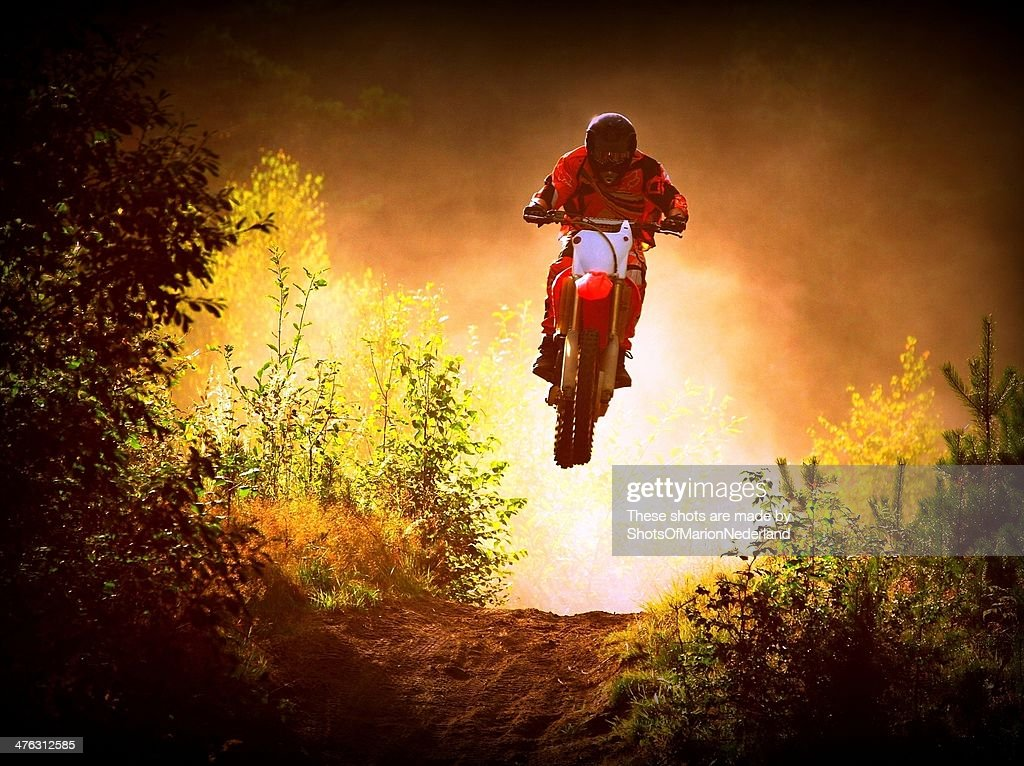 Jumping motocross in the forest