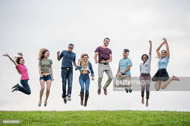 Jumping on a Grassy Hill Top
