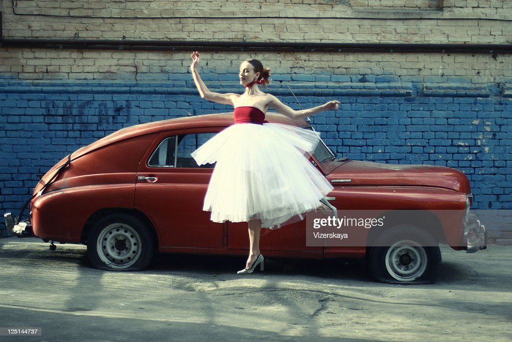 jumping women at retro car background