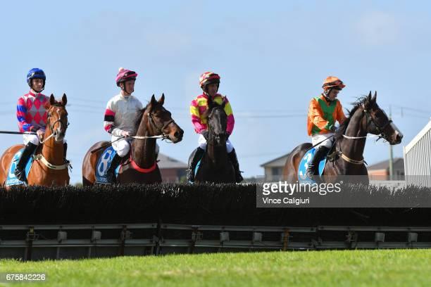 Jumps jockeys prepare their horses for Race 1 Maiden Hurdle during the Warrnambool Racing Carnival on May 2 2017 in Warrnambool Australia