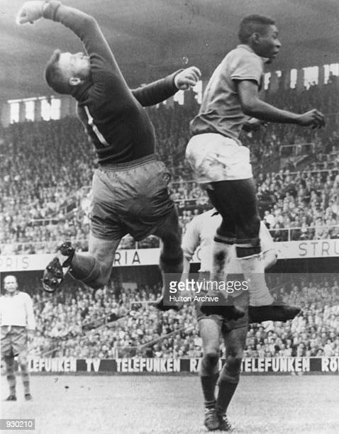 Pele of Brazil and Kalle Svensson of Sweden compete for the same ball during the FIFA World Cup Final played in Stockholm Sweden Brazil won the match...