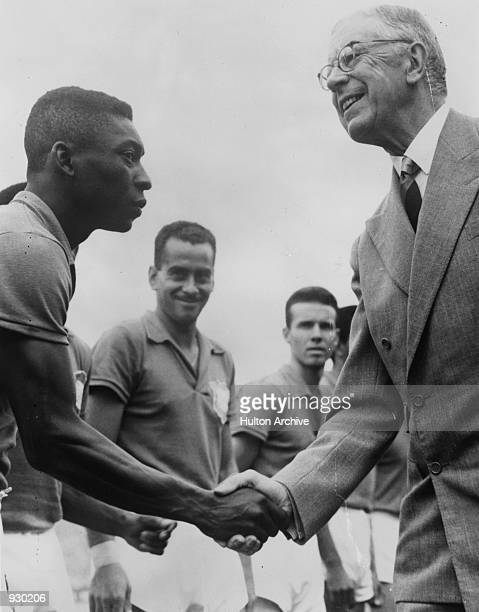 Pele of Brazil shakes hands with Gustav VI Adolf the King of Sweden before the FIFA World Cup Final against Sweden played in Stockholm Sweden Brazil...