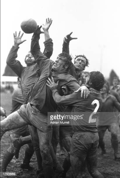 Muddy players jump for the ball in a lineout during a match between Westport and British Lions at Westport in New Zealand Mandatory Credit Adrian...