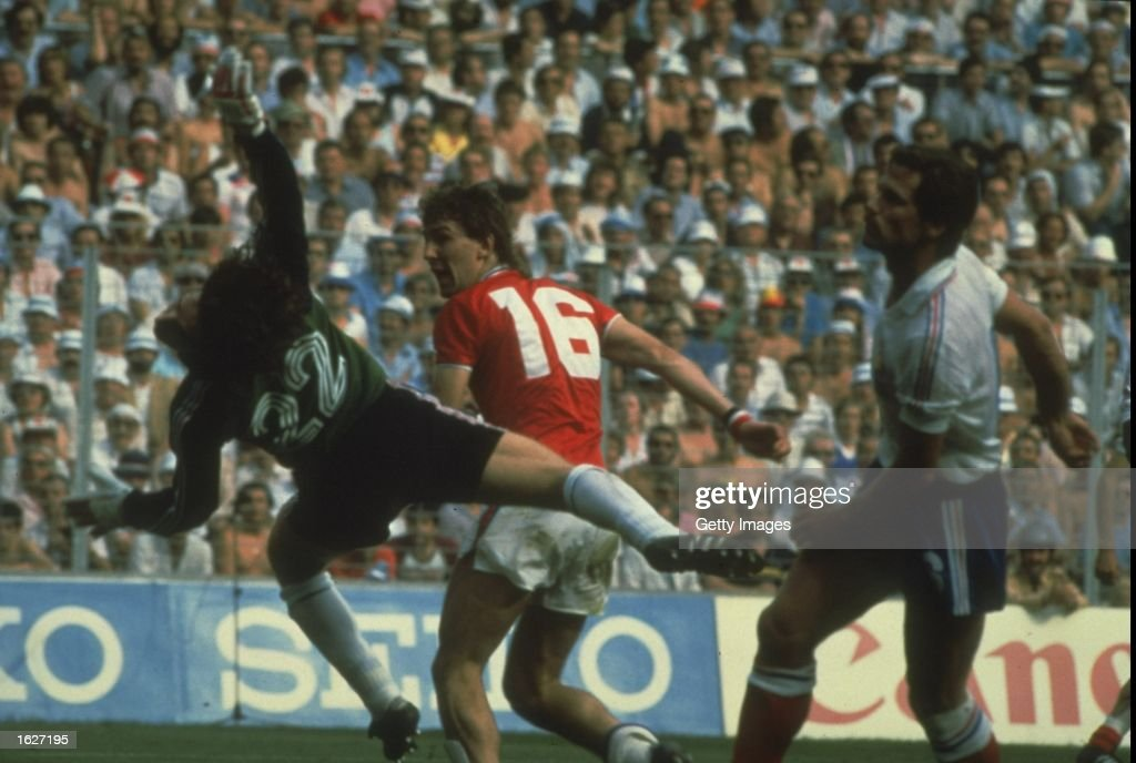Bryan Robson (centre) of England scores a goal during the World Cup match against France in Bilbao, Spain. England won the the match 3-1. \ Mandatory Credit: Allsport UK /Allsport