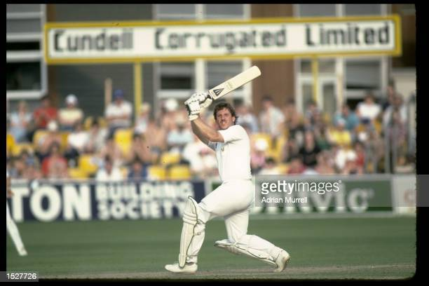 Ian Botham of Somerset hits six during the John Player league match against Essex Mandatory Credit Adrian Murrell/Allsport UK