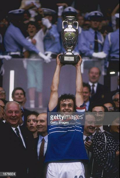 Michel Platini of France proudly holds aloft the European nations trophy after France defeated Spain by 20 in the Final which was played in Paris...