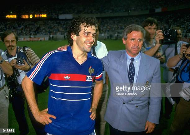 Michel Platini of France with coach Michel Hidalgo after victory in the European Championship Final against Spain at Parc des Princes in Paris France...