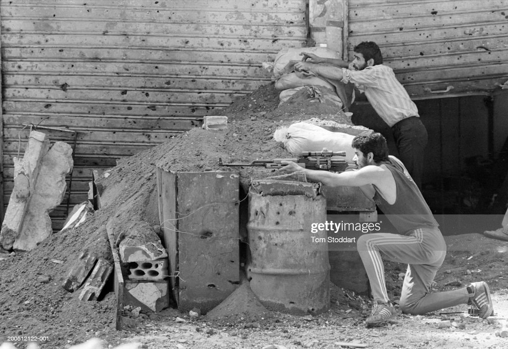 Jun 1986, A Palestinian fighter takes aim with his sniper rifle in the Bourj Al Barajneh refugee camp which was being attacked by Amal militia who besieged the camp for months during 1986.