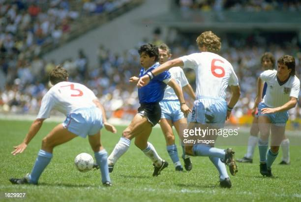 Diego Maradona of Argentina takes on Sansom and Terry Butcher of England during the World Cup quarterfinal at the Azteca Stadium in Mexico City...