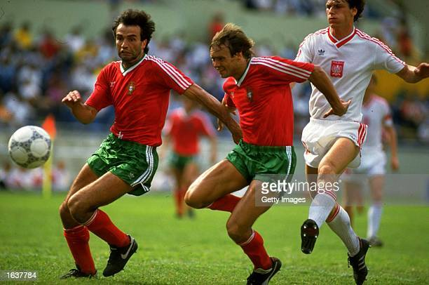 Frederico and Sousa of Portugal get away from Urban of Portugal during a World Cup match at the Universitario in Monterrey Mexico Portuugal won the...