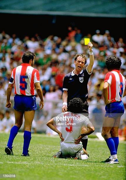 Hugo Sanchez of Mexico is booked in the World Cup match against Paraguay played in Mexico City Mexico The match finished in a 11 draw Mandatory...