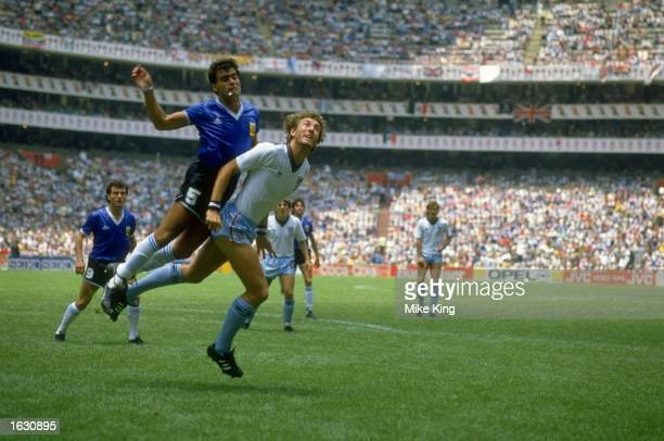 JoseLuis Brown of Argentina tangles with Terry Butcher of England during the World Cup quarterfinal at the Azteca Stadium in Mexico City Argentina...