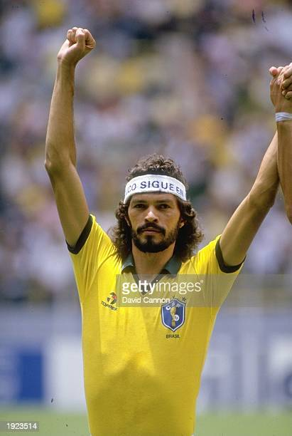 Socrates of Brazil holds his arms aloft in celebration during the World Cup First Round match against Spain at the Jalisco Stadium in Guadalajara...