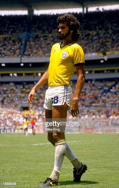 Socrates of Brazil takes a rest during the World Cup match against Spain at the Jalisco Stadium in Guadalajara Mexico Brazil won the match 10...