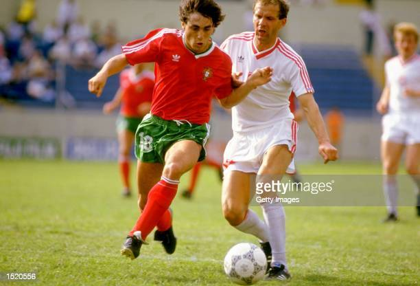 Sousa of Portugal takes on Buncol of Poland during the World Cup match at the Universitario Stadium in Monterrey Mexico Poland won the match 10...