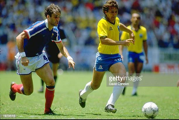Zico of Brazil takes on Batiston of France during the World Cup quarterfinal at the Jalisco Stadium in Guadalajara Mexico France won 43 on penalties...