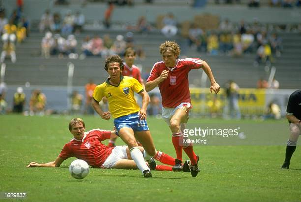 Zico of Brazil takes on Tarasiewicz of Poland during the World Cup Second Round match at the Jalisco Stadium in Guadalajara Mexico Brazil won the...