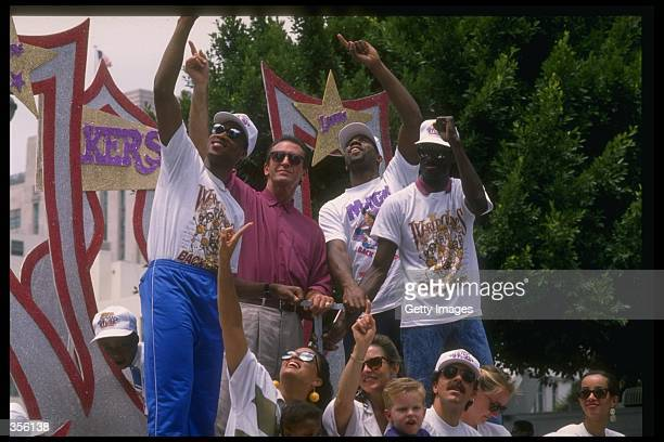 From left to right Byron Scott head coach Pat Riley Earvin Magic Johnson and Michael Cooper of the Los Angeles Lakers celebrate with their teammates...
