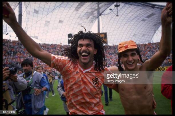 Ruud Gullit of Holland and teammate celebrate Holland's victory over Russia in the Final of the European nations championships in Munich Germany...