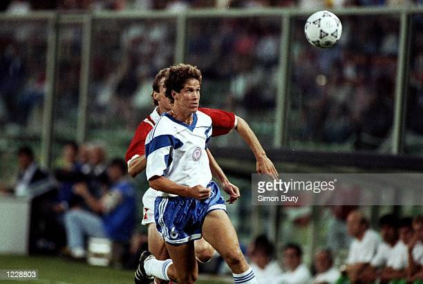 Bruce Murray of the USA in action during the World Cup match against Austria at the Comunale Stadium in Florence Italy Austria won the match 21...