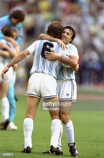 Calderon of Argentina celebrates with a team mate during the World Cup match against Brazil at the Delle Alpi Stadium in Turin Italy Argentina won...