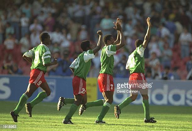 Cameroon players celebrate after winning the World Cup match against Colombia in Naples Italy Cameroon won the match 21 Mandatory Credit David...