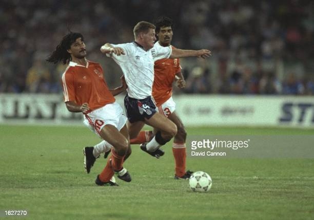 Paul Gascoigne of England takes on Ruud Gullitt of Holland during the World Cup match in Cagliari Italy The match ended in a 00 draw Mandatory Credit...