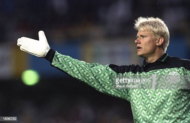 Denmark goalkeeper Peter Schmeichel indicates to his team mates during the European Championship match against Sweden at the Rasunda Stadium in...