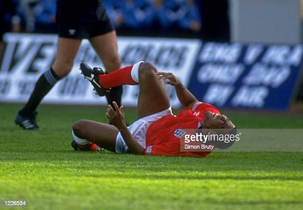 John Barnes of England is injured during a Friendly match against Finland in Helsinki Finland England won the match 21 Mandatory Credit Simon...