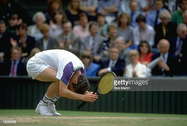John McEnroe of the USA curls into a ball during his match against Andre Agassi also of the USA at the Lawn Tennis Championships at Wimbledon in...