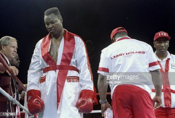 Larry Holmes stands in the ring with his robe on during his fight against Evander Holyfield in Las Vegas Nevada Holyfield won the fight with an...