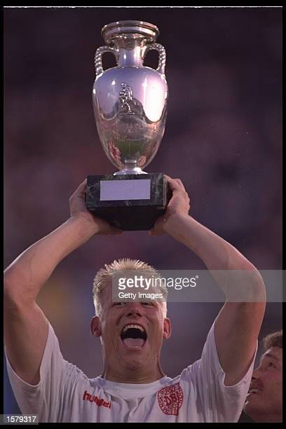 Peter Schmeichel of Denmark hold aloft the European nations trophy after Denmark defeats Germany by 20 in the final in Gothenburg Sweden Mandatory...