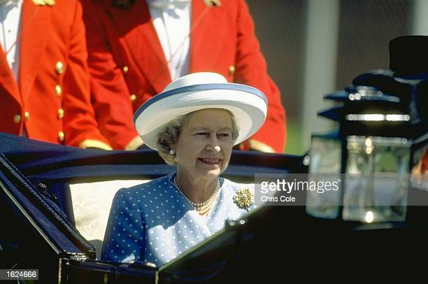 A portrait of Her Majesty the Queen Elizabeth II in an open carriage during Royal Ascot week at Ascot racecourse in Ascot England Mandatory Credit...