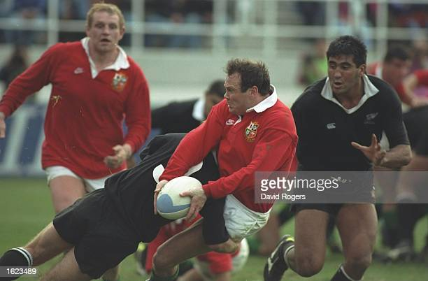 Ieaun Evans of the British Lions is tackled during the third test against New Zealand in Auckland New Zealand New Zealand won the match 3013 and took...
