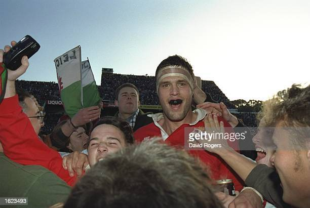 Martin Bayfield of the British Lions celebrates with fans after victory in the second test against New Zealand in Wellington New Zealand The Lions...
