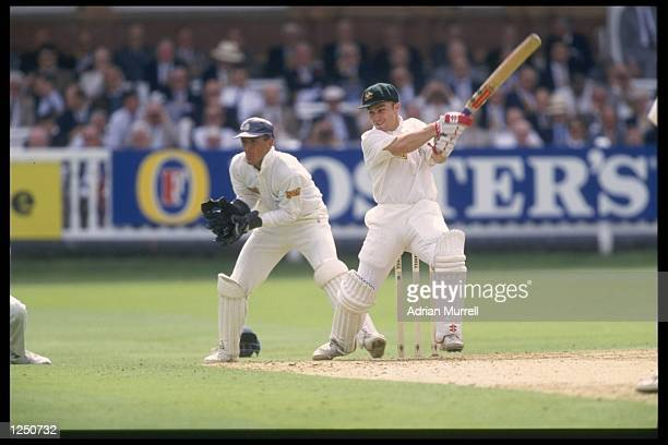 Michael Slater of Australia hits out during his innings of 162 against England in the 2nd Test at Lords The England wicketkeeper is Alec Stewart...