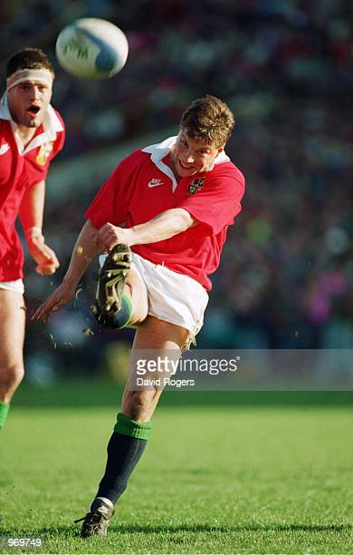 Rob Andrew of the British Lions kicks the ball forward during the Second Test Match against New Zealand played in Wellington New Zealand The British...