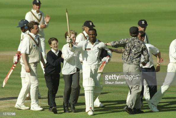 Brian Lara of Warwickshire is surrounded by fans after completing his World Record innings of 501 not out during the County Championship match...