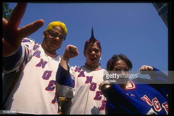 New York Rangers fans celebrate during a ticker tape parade in New York City New York Mandatory Credit Al Bello /Allsport