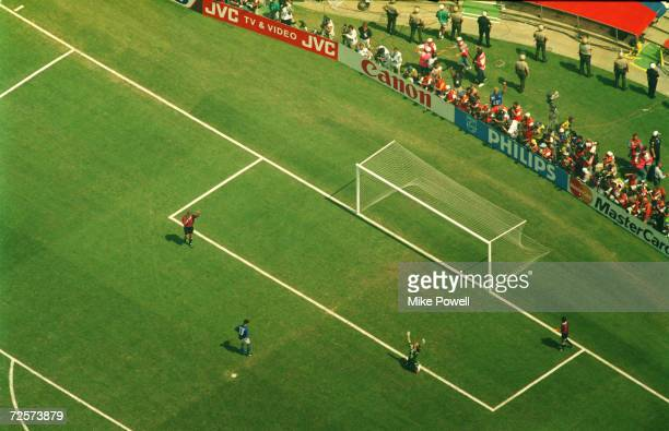 roberto baggio misses the decisive penalty as brazilian goalkeeper claudio taffarel falls to his knees and raises his arms in victory as brazil wins...