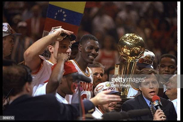 Center Hakeen Olajuwon of the Houston Rockets celebrates after a Finals game against the Orlando Magic at The Summit in Houston Texas The Rockets won...