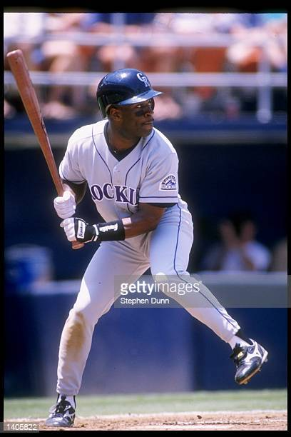 Infielder Eric Young of the Colorado Rockies swings at the ball during a game against the San Diego Padres at Jack Murphy Stadium in San Diego...