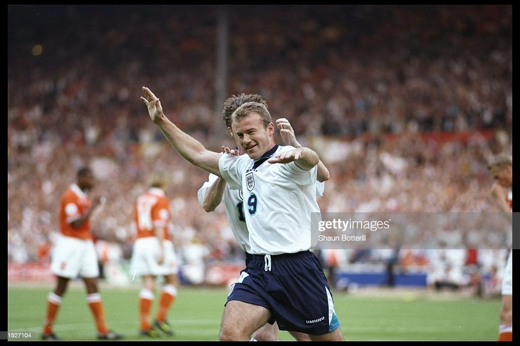 Alan Shearer of England celebrates his second and England's third goal against Holland in the Group A match at Wembley during the European Football...