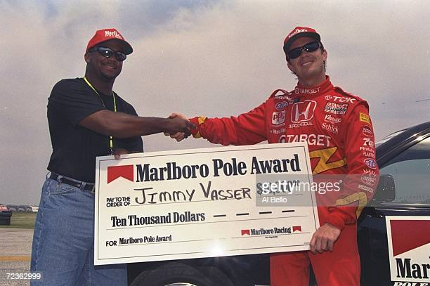 Alfonse Ribeiro presents Jimmy Vasser of Target Ganassi Racing the Marlboro Pole Award after Vasser took the pole for the Medic Drug Grand Prix in...