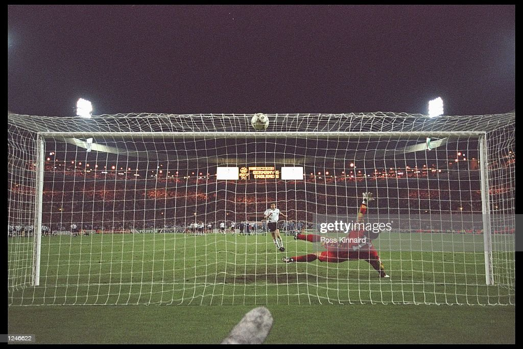 Andreas Moller of Germany scores the winning penalty during the European championship semi final match between England and Germany at Wembley Stadium, London. Germany won the match after extra time in a penalty shoot out 1(6) 1(5). Mandatory Credit: Ross Kinnaird/Allsport UK