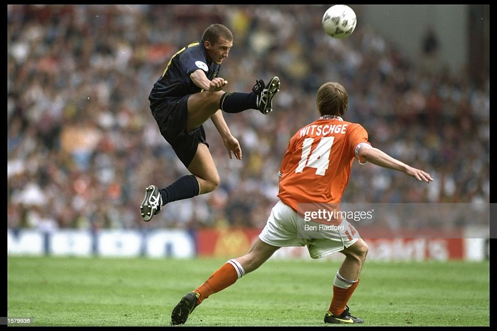 Billy McKinlay of Scotland in full flight is shadowed by Richard Witchge of Holland during the European soccer championship game between Holland and Scotland at Villa park, Birmingham. The match ended in a goaless draw.Mandatory Credit: /Allsport UK