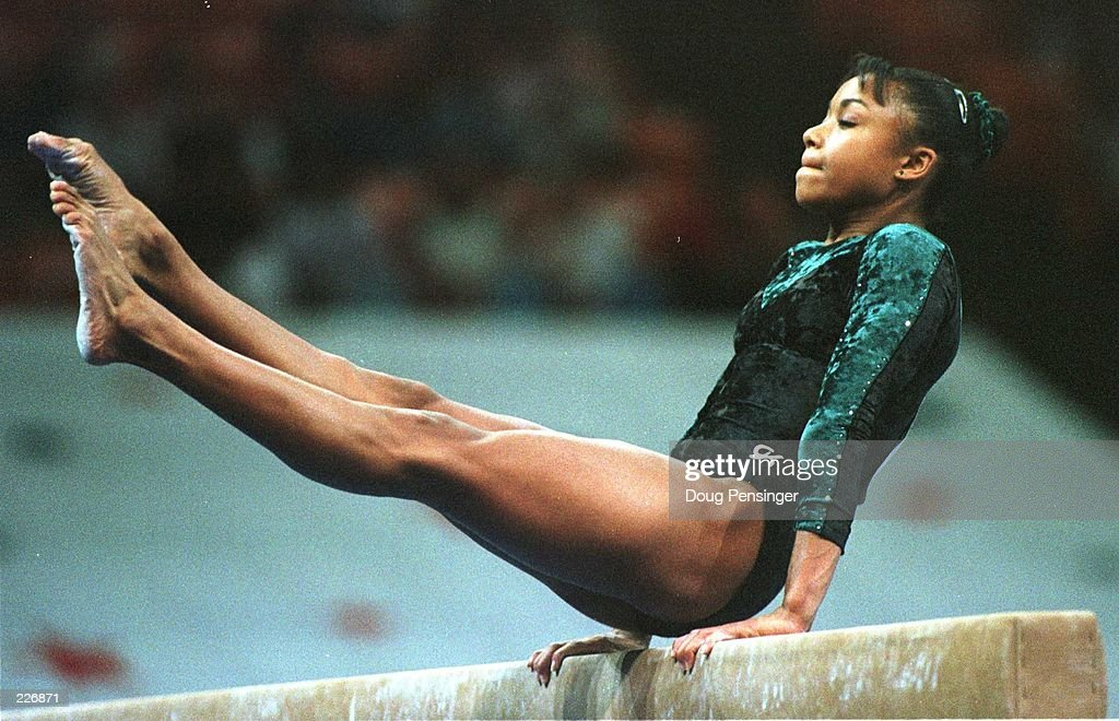 Dominique Dawes performs on the Balance Beam during the compulsory''s at the USA Gymnastics National Championships. Dawes, the Olympic hopeful, is in tenth place at the end of the first round of competition at the Thompson-Boling Arena on the c